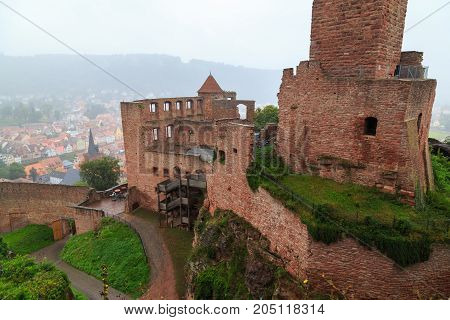 Ancient castle Wertheim. Top view from above of the ruined fortress walls and the old city in the fog. Germany. Tourist attraction