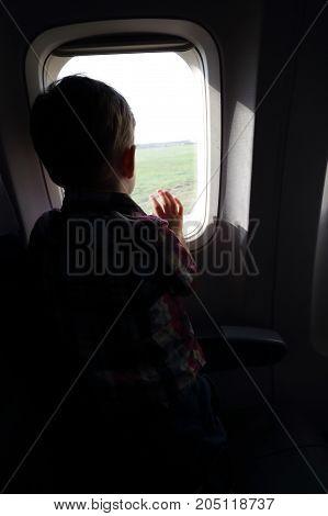 Boy Looking Through Porthole