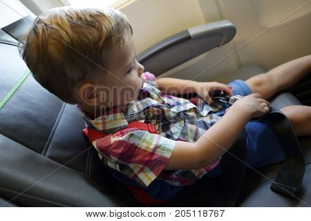 Child In Airplane