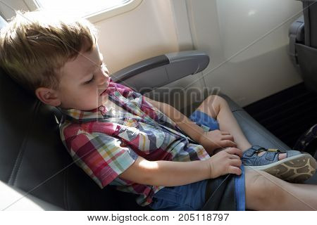 Kid In Airplane
