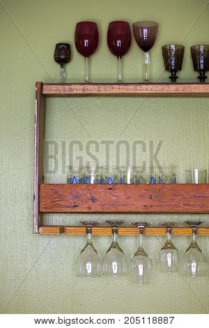 Retro home bar board with hanging wine glasses