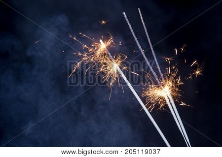 Burning Bengal lights with smoke against the background of the dark sky