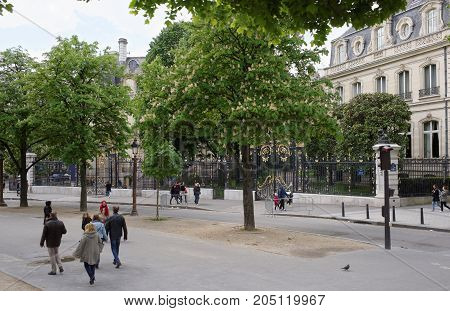 Paris; France- May 01; 2017: Champs Elysees. Pedestrians are walking along the street