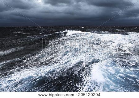 Huge Wave Splashing Down in Stormy Waters