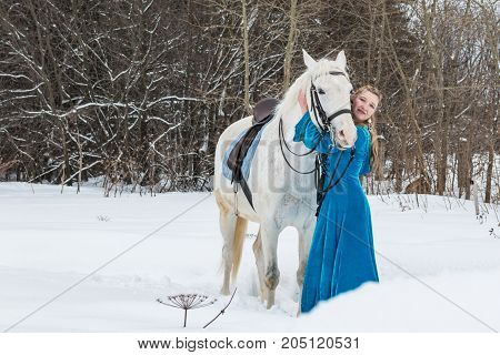 Woman In National Dress And White Horse In A Winter Forest