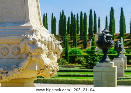 ACRE, ISRAEL - SEPTEMBER 18, 2017: Symbolic statue and a view of the Bahai gardens in Acre (Akko) Israel