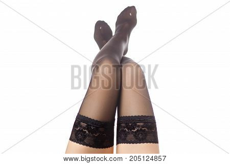 Female legs black nylon stockings on a white background isolation