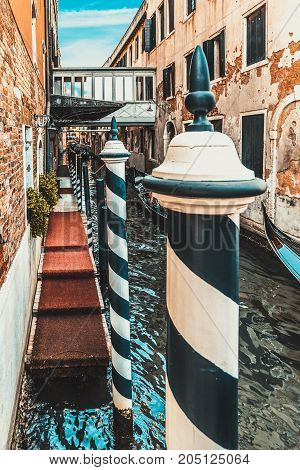 vintage Venetian street with the crossing over the canal, Italy