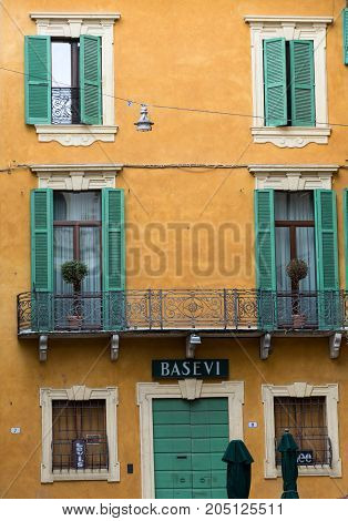 VERONA ITALY - MAY 1 2016:Old windows with wooden shutters in historic district of Verona. Italy