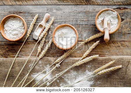 wheat and rye ear for flour production in bakery shop on wooden desk background top view