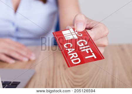 Closeup Of Woman's Hand Holding Gift Card