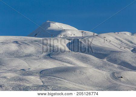 Winter landscape in the mountains. Mountain peak. Georgia, Gudauri ski resort.