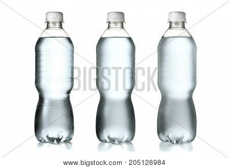 Plastic water bottles left one on room temperature middle one starting to condensate and the right one with little droplets all isolated on white background with clipping path