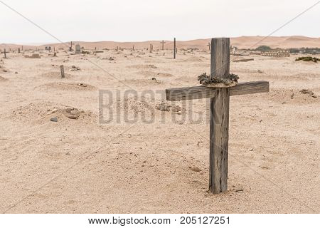 A grave in the historic Herero cemetery in Swakopmund in the Namib Desert on the Atlantic Coast of Namibia. Sand dunes are in the back