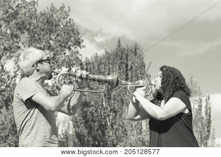 Man And Woman Playing Trumpet
