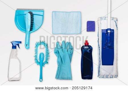 High Angle View Of Cleaning Equipments On White Background