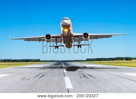 Passenger Airplane Fly Over The Runway In Good Weather