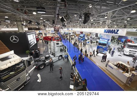 MOSCOW, SEP, 5, 2017: View on cars trucks exhibits on Commercial Transport Exhibition ComTrans-2017. Automobile industry new concepts models. Trucks buses cars custom vehicles exhibition stands booth