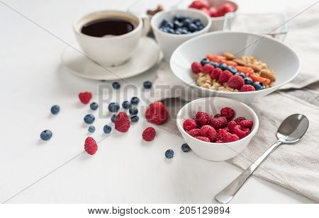 tasty oatmeal with berries healthy breakfast background with oatmeal coffee, berries, egg, nuts.