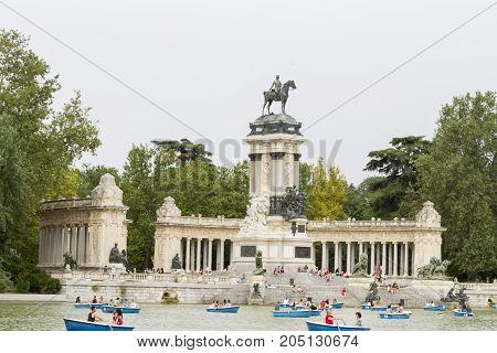 People Enjoy Summer Evening In In Buen Retiro Park On June 28, 2016 In Madrid, Spain. Buen Retiro Pa