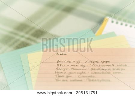 Russian; Learning New Language Writing Greetings On The Notebook