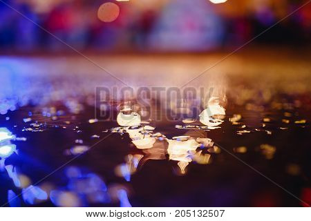Abstract blurred background with yellow leaves, drops of water, bokeh.