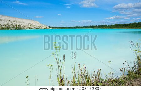 Critical environmental area with alkaline lake and industrial wasteland