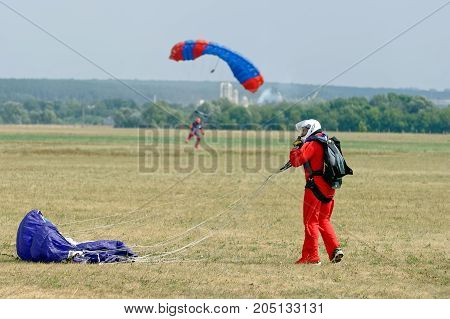 Kharkiv Ukraine - August 26 2017: Skydiver landed after the jump at the airfield Korotych Kharkov region Ukraine on August 26 2017