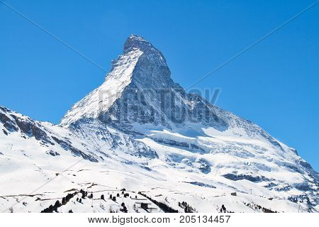 The summit of the Matterhorn in Alps and covered with snow.