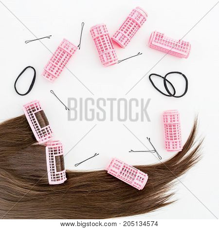 Hair and women's accessories. Curlers. Flat lay. Top view.