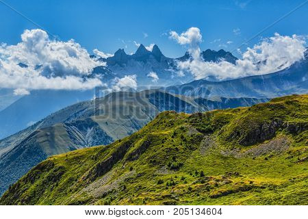 Landscape in Alps with Aiguilles d'Arves in the distance.