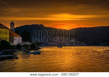 Sunset over Vis island during golden hour, croatian famous travel destinations.
