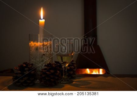 Wine And Fir Cones In Front Of A Fire