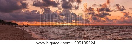 Panoramic picture of a sunset over the sea beach in Sarbinowo,Baltic Sea,Poland