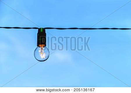 lamp, light, muffled light, incandescent lamp, light source, against the blue sky one lamp