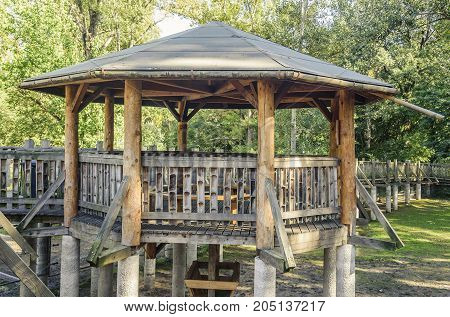 Wooden arbor with bridges of wood in the park.