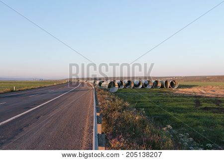 Large concrete pipes waiting for infrastructure work.