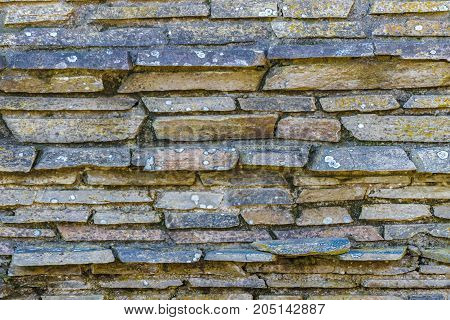 Detail view of stone patterned house wall facade