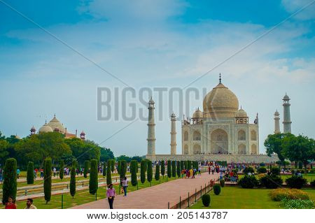 Agra, India - September 20, 2017: Unidentified people walking and enjoying the beautiful Taj Mahal, is an ivory-white marble mausoleum on the south bank of the Yamuna river in the Indian city of Agra, Uttar Pradesh.