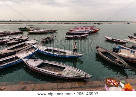VARANASI INDIA - MARCH 13 2016: Wide angle picture of many docked boats at Ganges River in the city of Varanasi in India