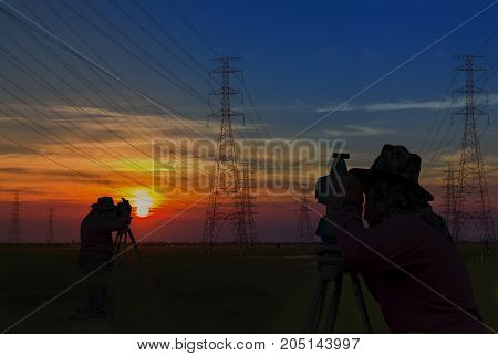 Double exposure Silhouette man working survey on electric tower pole construction building in sunrise sky