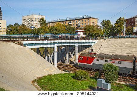 The city of Novosibirsk Siberia Russia - September 17 2017: automotive-pedestrian bridge over the railroad tracks in the center of Novosibirsk station