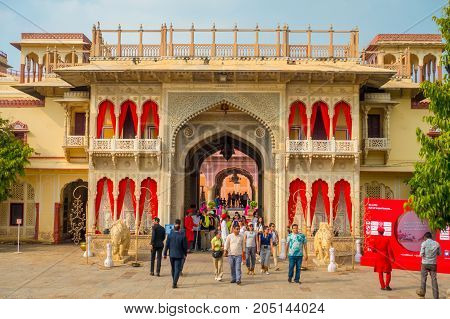 JAIPUR, INDIA - SEPTEMBER 19, 2017: Unidentified people at the entrance gate to the City Palace in Jaipur, India.