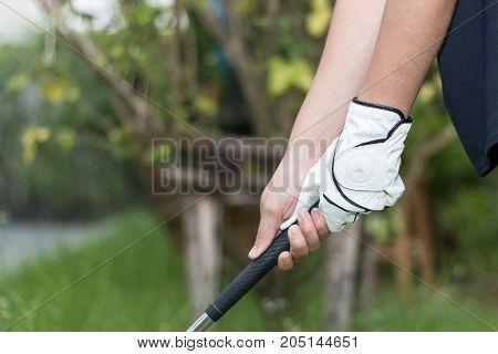 Golfer Wearing White Glove Holdiing Golf Club