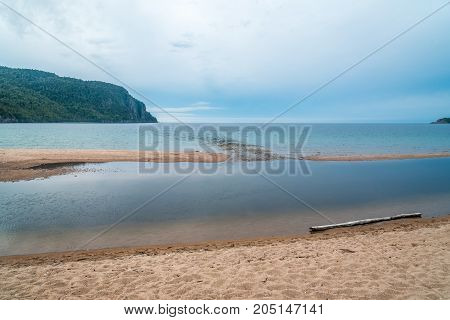 Sand beach and blue water of Superior Lake Canada