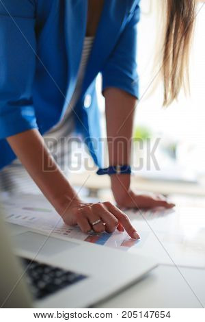 Woman sitting on the desk with laptop