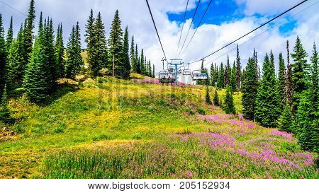 Taking the chairlift up to do a hike to the top of Tod Mountain at Sun Peaks village in the Shuswap Highlands of central British Columbia, Canada