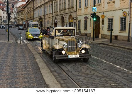 PRAGUE CZECH REPUBLIC - FEBRUARY 02 2014: Tour of the city on an old car. Prague is the capital and largest city of the Czech Republic.