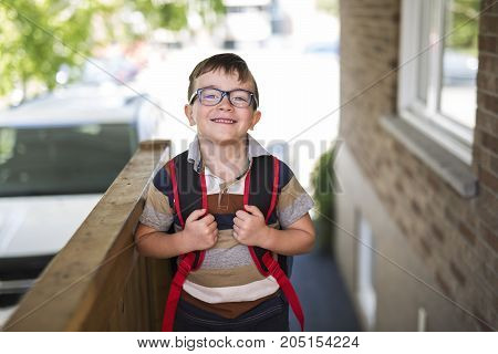 A Beautiful little boy with backpack ready back to school