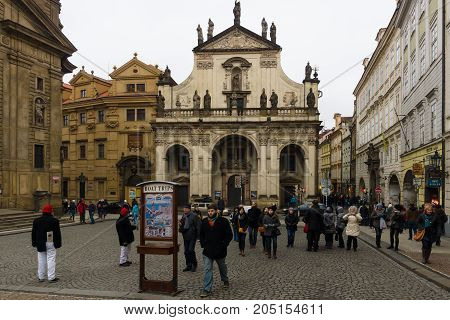 PRAGUE CZECH REPUBLIC - FEBRUARY 02 2014: The streets of old Prague. Saint Salvator Church Charles Bridge in Prague